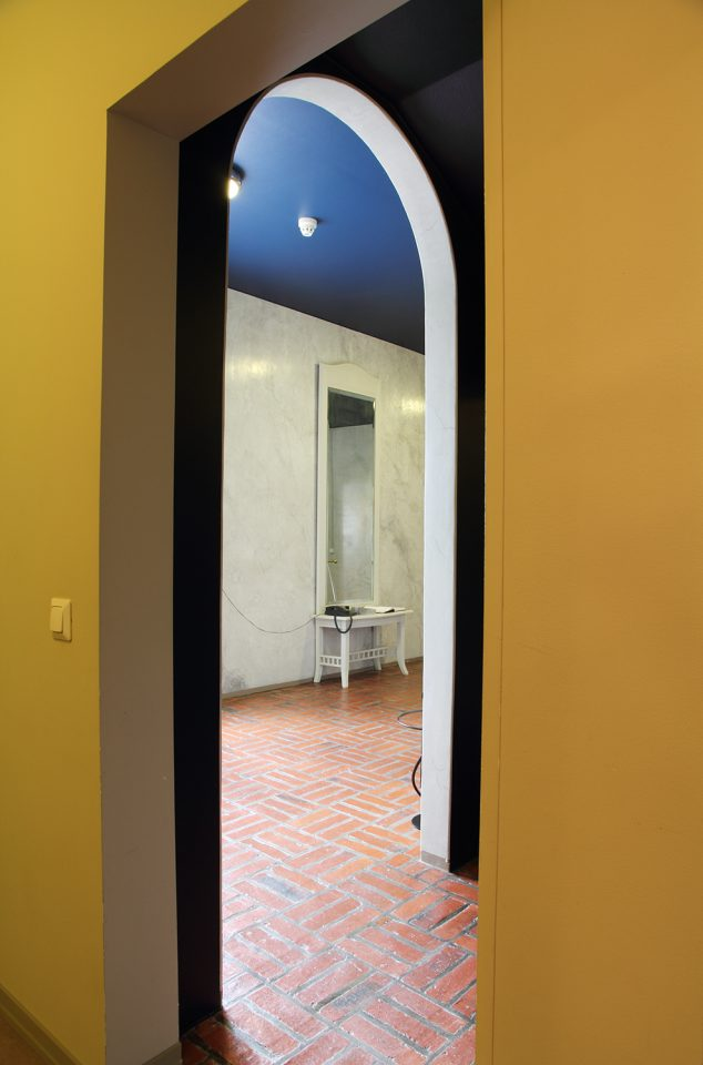 The entrance hall floors are in brick and the walls are finished in greyish white stucco, Villa Solin