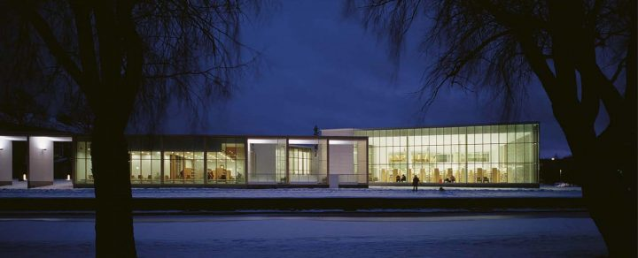 Building illuminates the landscape in the night time, Rauma Main Library