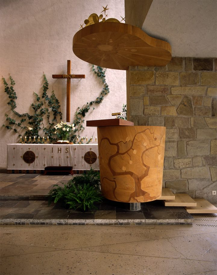 The pulpit. The intarsia work and decorations for the baldachin were designed by Erik Bryggman, Resurrection Chapel